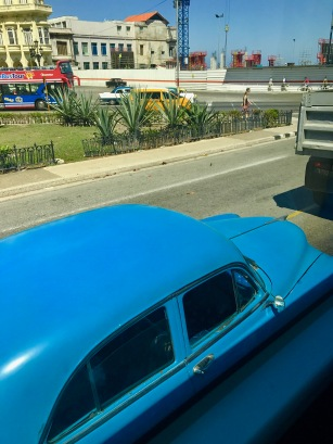 View from the Bus: Blue car